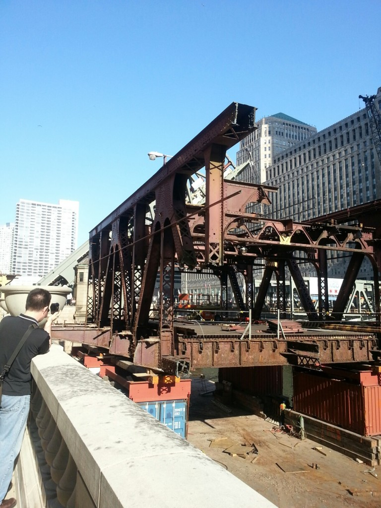 Cut off old section of Wells Street bridge.